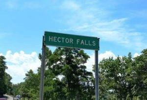 Hector Falls Sign  300x205 - Meet Chris and June - 4 Reasons to Trust the Universe While Traveling